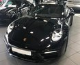 Rent-a-car Porsche 911 Carrera 4S Cabriolet (black) with its delivery to Venice airport, photo 5