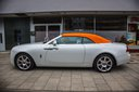 Rent-a-car Rolls-Royce Dawn White in Milan, photo 1